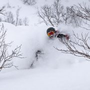 Brian Muller going through powder. Photo by Sea and Summit Photography